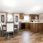 TRUMH SATISFACTION Mobile Home Kitchen and Dining Area